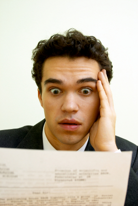 surprised-man-reading-letter